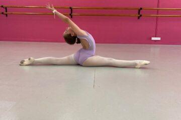 Ballet Dancer in Ballet Class Stretching on the floor of the Ballet Studio in Joondalup